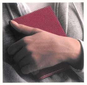 holding red notebook